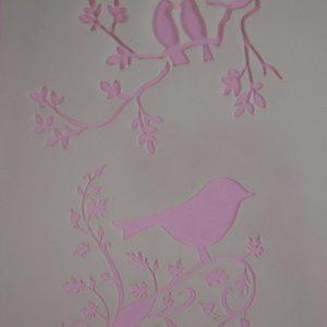 Stencil vogels op tak